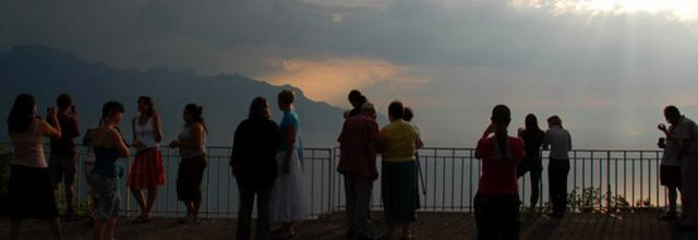 People standing around at Dusk